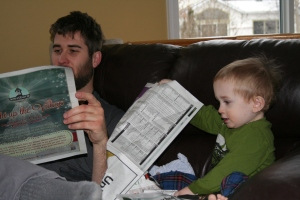 Before class, reading the paper with dad.
