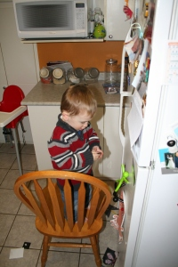 What Henry would rather do on Christmas morning, rearrange the fridge magnets.