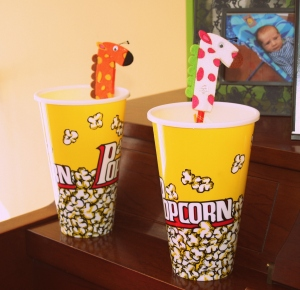 Party favours for the kids. Popcorn bowls filled with animal cracker pouches and a zebra/horse pen.