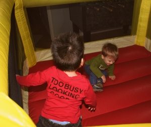 Henry and Luis enjoying the bouncy castle. Luis just ran right in the second it was done blowing up.