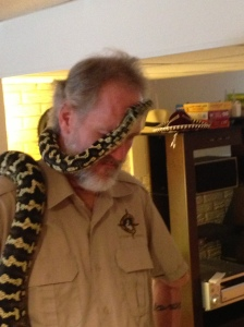 Snake getting mighty comfy on the reptile handler. I was cringing inside the whole time.