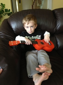 Henry's spent the morning in a daze just strumming the ukelele.. I think he'll perform something for us tonight around midnight.