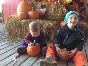 posing for pictures in front of the pumpkins. I took a picture of Henry and his friend Avery at this very spot 2 years ago. How time flies!