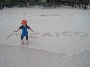 We like to spell out the place we are in the sand whenever we travel. Henry loves this tradition.