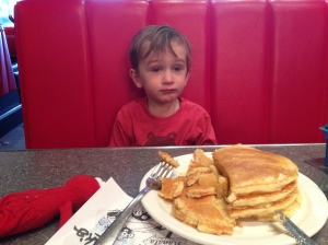 Overwhelmed by the amount of pancakes he got.