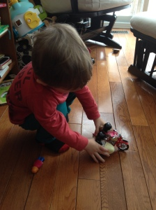 Playing with his little motorcycle