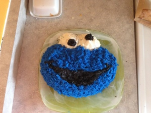 I made this Cookie Monster cake for Henry. It was my first time attempting to decorate a cake and I was pretty happy with the results even though I got icing all over my hands and a bit on Freddy's head also (he was clinging to my leg the entire time)