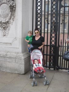 They boys and I posing in front of Buckingham Palace