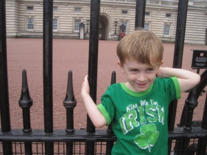 "Henry wearing his ""kiss me I'm Irish"" shirt in front of Buckingham Palace with a guard in the background."