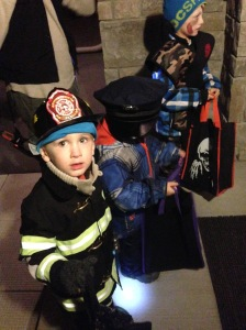 My little fireman, next to his cousins the policeman and the army ninja...